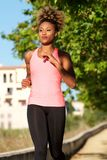 Young afro american woman running outdoors in morning Stock Photography