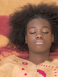 Portrait of a young Afro girl, eyes closed stock photo