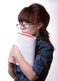 Portrait of young alluring brunette woman. Holding book on white background Stock Photos
