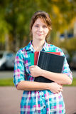 Portrait of young alluring woman holding education Royalty Free Stock Photography