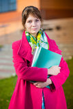 Portrait of young alluring woman holding education Stock Photos