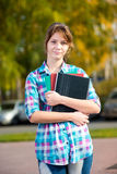 Portrait of young alluring woman holding education Stock Image