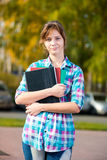Portrait of young alluring woman holding education Stock Photography