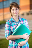 Portrait of young alluring woman holding education Stock Images