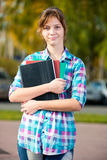 Portrait of young alluring woman holding education Royalty Free Stock Images