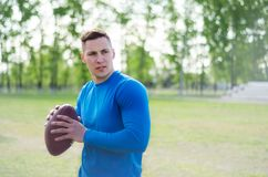 Portrait of a young american football player with a ball in training royalty free stock photo
