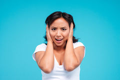 Portrait of a young angry asian woman covering her ears Royalty Free Stock Photography