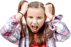 Portrait of a young angry caucasian female teen, on white. Royalty Free Stock Photos