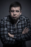 Portrait of young angry man with arms crossed Stock Image