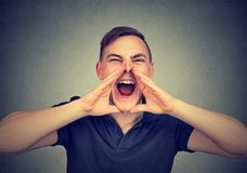 Portrait of young angry man screaming stock images