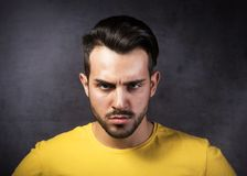 Portrait of young angry man Stock Photos