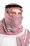 Portrait of a young Arab wearing a turban. Isolated on white background Stock Image