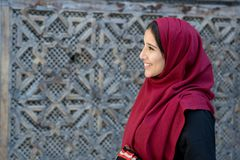 Portrait of young Arab woman in traditional clothing with red hi. Portrait of beautiful Arab woman in traditional clothing with red hijab in traditional ambient Royalty Free Stock Image