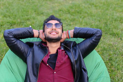 Portrait of Young Arabic Male Man, Student Lies on Chair, Smilin Royalty Free Stock Photography