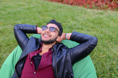 Portrait of Young Arabic Male Man, Student Lies on Chair, Smilin Stock Photos