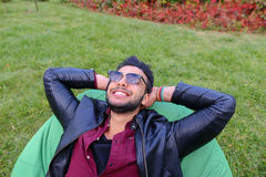 Portrait of Young Arabic Male Man, Student Lies on Chair, Smilin Royalty Free Stock Images