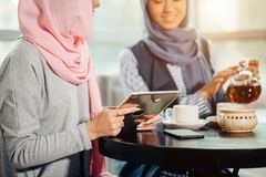 Portrait of young arabic woman working with tablet Royalty Free Stock Photos