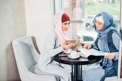 Portrait of young arabic woman working with tablet Stock Photos