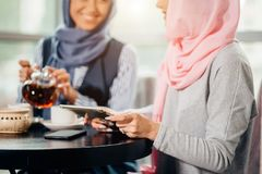 Portrait of beautiful Arabic Muslim girl using tablet. Portrait of young arabic women working with tablet Royalty Free Stock Photo