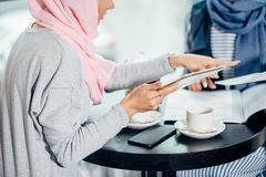 Portrait of beautiful Arabic Muslim girl using tablet. Portrait of young arabic women working with tablet Royalty Free Stock Image