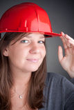Portrait of young architect wearing red hardhat Royalty Free Stock Images