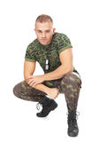 Portrait of young army soldier squatting Royalty Free Stock Photo