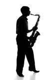 Portrait of a young artist with a sax Royalty Free Stock Photo