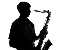 Portrait of a young artist with a sax Stock Images