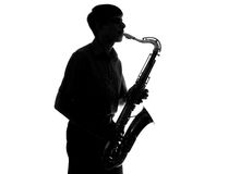 Portrait of a young artist with a sax Stock Photos