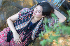 Portrait of young Asia beautiful girl relaxing on hammock on the Royalty Free Stock Photo