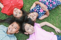 Portrait of young asian boy girls having good time in the park stock photos