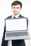 Portrait of young asian business man black suit holding laptop c Stock Photography