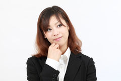 Portrait of young asian business woman thinking Royalty Free Stock Photos