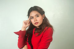 A portrait of young Asian businesswoman thinking . Stock Photos
