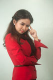 A portrait of young Asian businesswoman thinking . Stock Image