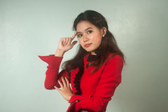 A portrait of young Asian  businesswoman thinking . Stock Photo