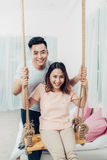 Portrait of young asian couple relaxing at home Stock Images