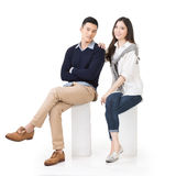 Portrait of young Asian couple sit Stock Photography