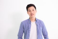Portrait young asian engineer in white background. Portrait of a young cheerful casual asian handsome man in plaid shirt opened button and white t-shirt looking royalty free stock photography