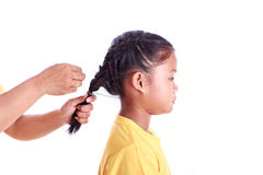 Portrait of young Asian girl while braiding hair isolated on whi Stock Photography