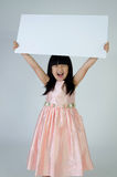 Portrait of young Asian girl holding blank billboard Royalty Free Stock Photo