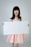 Portrait of young Asian girl holding blank billboard Stock Images
