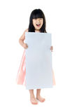 Portrait of young Asian girl holding blank billboard Royalty Free Stock Photography