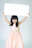 Portrait of young Asian girl holding blank billboard Stock Photos
