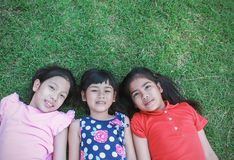 Portrait of young asian girls having good time in the park royalty free stock image