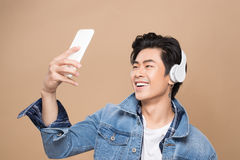 Portrait of a young asian handsome man with headphones smiling a Stock Photo