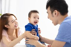 Portrait of young happy family with baby royalty free stock photography