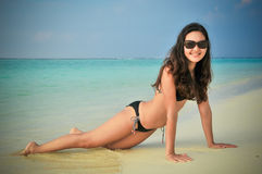 Portrait of young asian looking woman lie down in bikini at  tropical beach at Maldives Stock Photos