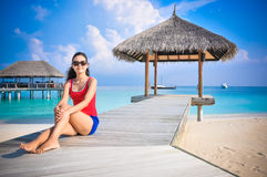 Portrait of young asian looking woman sitting near hut at beautiful tropical beach at Maldives Stock Photography