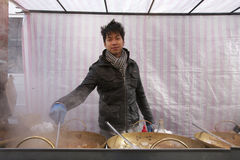 Portrait of a young Asian man cooking at street food stall Royalty Free Stock Photo